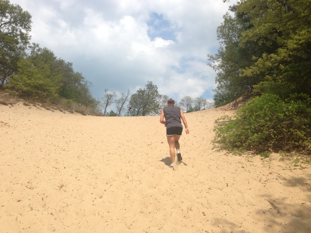 Lisa trekking up the first of three steep dunes.