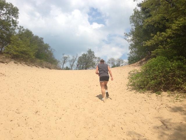 Lisa trekking up the first of three steep dunes.